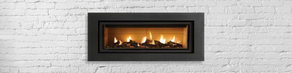 Heating your home with a wood or gas fireplace like the one pictured here is a cozy solution to staying warm